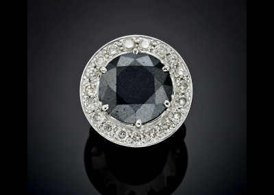 Handmade black diamond circled with white diamond halo in 18ct white gold