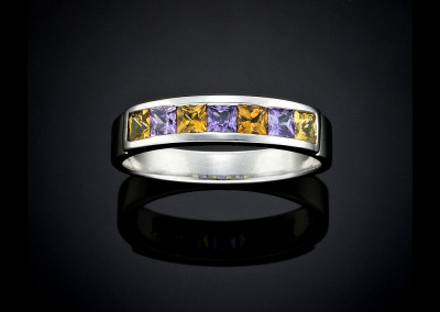 Handmade purple and golden sapphire ring in white gold