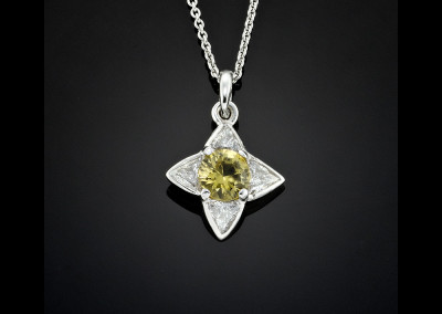 Heliodor beryl and diamond pendant made in 18ct white gold